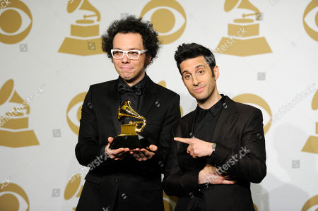 Ian Axel, left, and Chad Vaccarino, of A Great Big World pose in the press room with the award for best pop duo/group performance for Say Something at the 57th annual Grammy Awards at the Staples Center, in Los Angeles