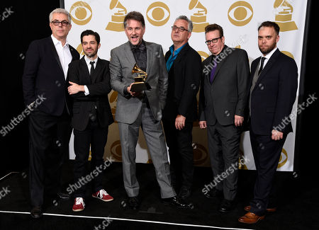 Gregg Field, from left, Andrew Synowiec, Gordon Goodwin, Sal Lozano, Bernie Dresel and Kevin Garren, of Gordon Goodwinâ?™s Big Phat Band, pose in the press room with the award for best large jazz ensemble album for â?oeLife in the Bubbleâ?? at the 57th annual Grammy Awards at the Staples Center, in Los Angeles