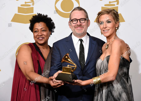 "Lisa Fischer, from left, Morgan Neville and Caitrin Rogers pose in the press room with the award for best music film for ""20 Feet From Stardom"" at the 57th annual Grammy Awards at the Staples Center, in Los Angeles"