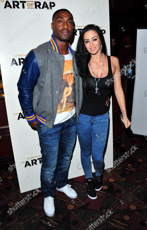 Simon Webbe and Maria Koukas poses at The Art of Rap World Premiere at Hammersmith Apollo on in London