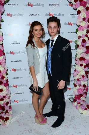 Stock Image of Maia Penfold and Tyger Drew-Honey arrive for a VIP screening of The Big Wedding at the Mayfair Hotel in London on