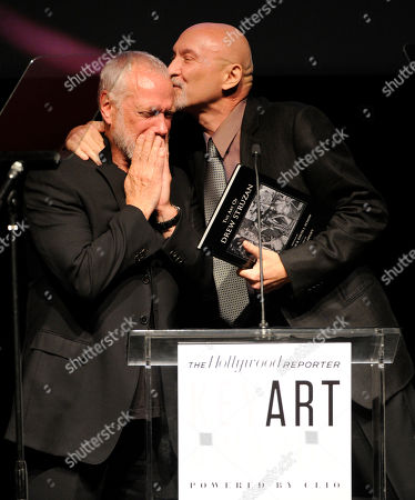 Frank Darabont, right, presents the Saul Bass award to Drew Struzan at The Hollywood Reporter Key Art Awards Powered by Clio at the Dolby Theatre, in Los Angeles