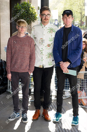 From left, Gwil Sainsbury, Gus Unger-Hamilton and Thom Green from the British band Alt-J arrive for the Ivor Novello Awards 2013, in London