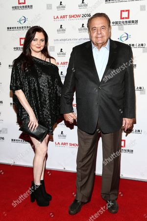 Paul Sorvino, right, and Dee Dee Benkie attends The LA Art Show and The LA Fine Art Show Opening Night Premiere Party held at the LA Convention Center, in Los Angeles