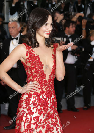Laetitia Guarino poses for photographers upon arrival for the screening of the film The Sea of Trees at the 68th international film festival, Cannes, southern France