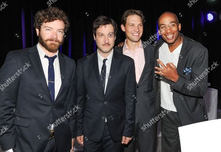"""Cat members from """"Men At Work"""", from left, Danny Masterson, Adam Busch, Michael Cassidy and James Lesure attend the TNT and TBS 2013 Upfront at the Hammerstein Ballroom on in New York"""