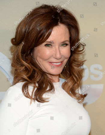 Mary McDonnell poses backstage at the TNT and TBS Network 2014 Upfront Presentations at Madison Square Garden, in New York