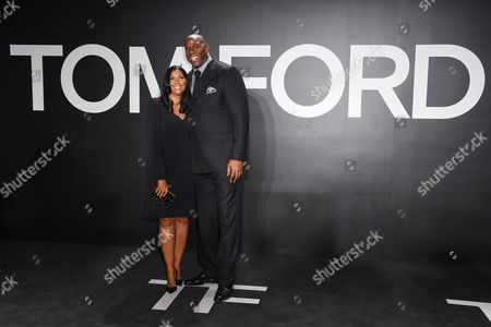 Earlitha 'Cookie' Kelly, left, and Earvin 'Magic' Johnson arrive at the Tom Ford Autumn/Winter 2015 Womenswear Presentation at Milk Studios, in Los Angeles
