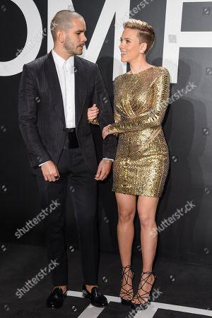 Scarlett Johansson, left and journalist Romain Dauriac arrive at the Tom Ford Autumn/Winter 2015 Womenswear Presentation at Milk Studios, in Los Angeles