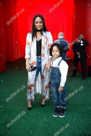 Tia Mowry and Cree Taylor Hardrict seen at Twentieth Century Fox Premiere of 'The Peanuts Movie' at Regency Village Theater, in Los Angeles, CA