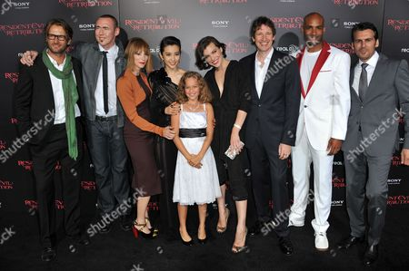 """From left, Johann Urb, Kevin Durand, Sienna Guillory, Li Bingbing, Aryana Engineer, Milla Jovovich, Paul W.S. Anderson and actors Boris Kodjoe and Oded Fehr attend the US premiere of """"Resident Evil: Retribution"""" at Regal Cinemas L.A. Live on in Los Angeles"""
