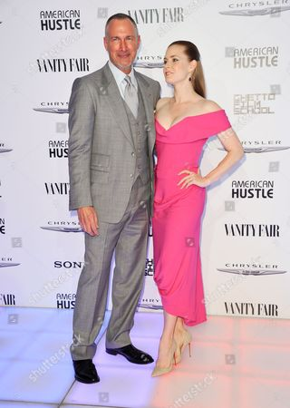 """Stock Photo of Amy Adams, right, and Edward Menicheschi arrive at the Vanity Fair and Chrysler Toasts the """"American Hustle"""" Cast on Thursday, Feb, 27, 2014 in West Hollywood, Calif"""