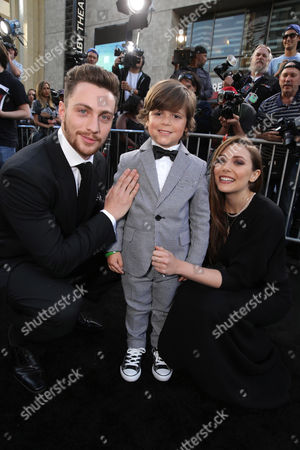 Stock Picture of Aaron Taylor-Johnson, Carson Bolde and Elizabeth Olsen seen at Warner Bros. Pictures and Legendary Pictures Present the Los Angeles Premiere of 'Godzilla' at Dolby Theatre, in Hollywood
