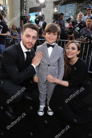 Aaron Taylor-Johnson, Carson Bolde and Elizabeth Olsen seen at Warner Bros. Pictures and Legendary Pictures Present the Los Angeles Premiere of 'Godzilla' at Dolby Theatre, in Hollywood