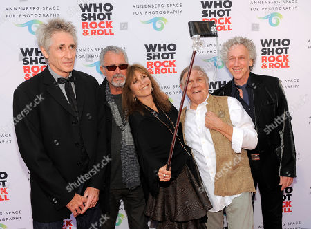 """Music photographers, from left, Ed Colver, Guy Webster, Lynn Goldsmith, Henry Diltz and Bob Gruen pose together for a photo on the red carpet at the """"Who Shot Rock and Roll"""" photo exhibition opening at the Annenberg Space for Photography on in Los Angeles"""