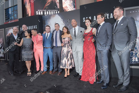 "Producer Hiram Garcia, from left, Archie Panjabi, Colton Haynes, Hugo Johnstone-Burt, Director Brad Peyton, Carla Gugino, Dwayne Johnson, Alexandra Daddario, Ioan Gruffudd and Producer Beau Flynn arrive at the World Premiere Of ""San Andreas"" held at the TCL Chinese Theater, in Los Angeles"
