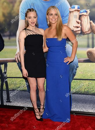 """Amanda Seyfried, left, and Jessica Barth attend the world premiere of """"Ted 2"""" at the Ziegfeld Theatre, in New York"""