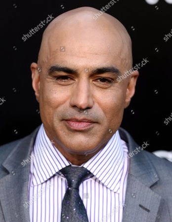 """Faran Tahir arrives at the world premiere of """"Elysium"""" at the Regency Village Theater on in Los Angeles"""