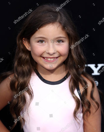 """Emma Tremblay arrives at the world premiere of """"Elysium"""" at the Regency Village Theater on in Los Angeles"""