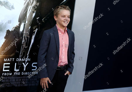 """Maxwell Perry Cotton arrives at the world premiere of """"Elysium"""" at the Regency Village Theater on in Los Angeles"""