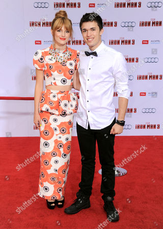 """Bella Thorne, left, and Remy Thorne arrive at the world premiere of """"Marvel's Iron Man 3"""" at the El Capitan Theatre, in Los Angeles, Calif"""