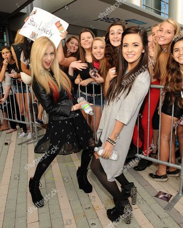 Liz and Megan Mace appears during the Y100's Jingle Ball 2012 at the BB&T Center on in Ft Lauderdale, Florida