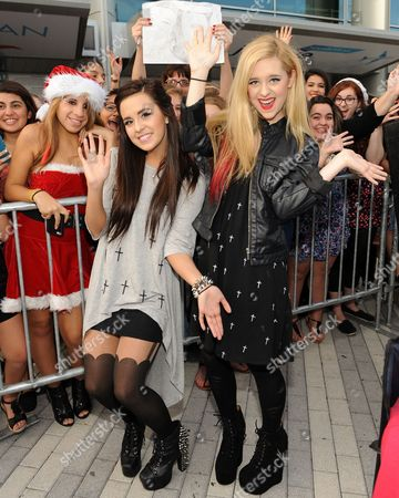 Megan and Liz Mace appear during the Y100's Jingle Ball 2012 at the BB&T Center on in Ft Lauderdale, Florida