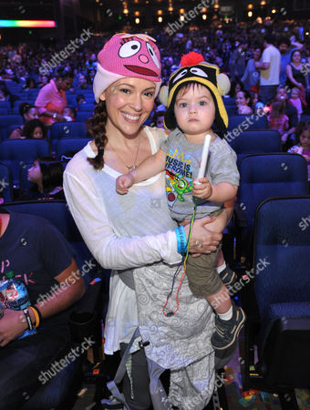 Alyssa Milano, left, and son Milo Bugliari attend attend Yo Gabba Gabba! Live!: Get The Sillies Out! 50+ city tour kick-off performance on Thanksgiving weekend at Nokia Theatre L.A. Live on in Los Angeles