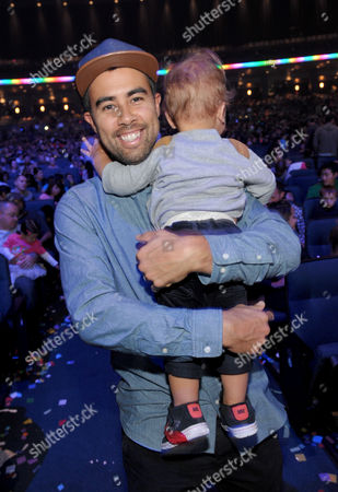 Stock Picture of Eric Koston and son attends Yo Gabba Gabba! Live!: Get The Sillies Out! 50+ city tour kick-off performance on Thanksgiving weekend at Nokia Theatre L.A. Live on in Los Angeles