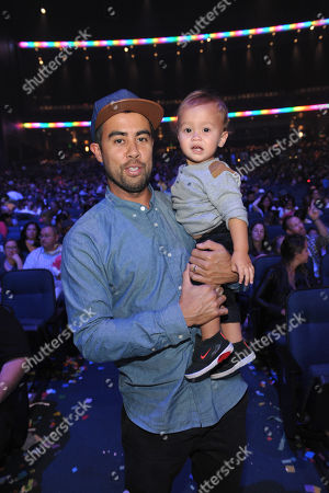 Stock Image of Eric Koston and son attends Yo Gabba Gabba! Live!: Get The Sillies Out! 50+ city tour kick-off performance on Thanksgiving weekend at Nokia Theatre L.A. Live on in Los Angeles