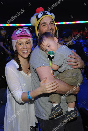 From left, Alyssa Milano, David Bugliari and son Milo Bugliari attend Yo Gabba Gabba! Live!: Get The Sillies Out! 50+ city tour kick-off performance on Thanksgiving weekend at Nokia Theatre L.A. Live on in Los Angeles