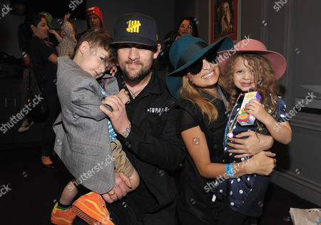 Joel Madden, 2nd left, Nicole Richie, 2nd right, and their children Sparrow Madden, left, and Harlow Madden, right, attend Yo Gabba Gabba! Live!: Get The Sillies Out! 50+ city tour kick-off performance on Thanksgiving weekend at Nokia Theatre L.A. Live on in Los Angeles