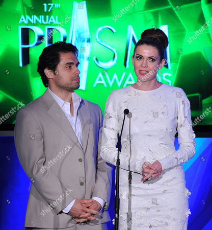 Actors Carly Steel, right, and Danny Arroyo present an award at the 17th Annual Prism Awards Ceremony at The Beverly Hills Hotel, in Beverly Hills, Calif