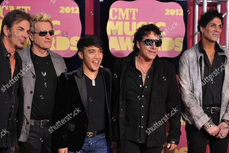 Stock Photo of From left, Jonathan Cain, Ross Valory, Arnel Pineda, Neal Schon and Deen Castronovo of Journey arrive at the 2012 CMT Music Awards on in Nashville, Tenn