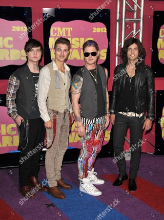 From left, Musicians Jamie Follese, Ryan Follese, Nash Overstreet and Ian Keaggy of Hot Chelle Rae arrive at the 2012 CMT Music Awards on in Nashville, Tenn