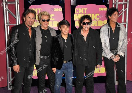 From left, Jonathan Cain, Ross Valory, Arnel Pineda, Neal Schon and Deen Castronovo of Journey arrive at the 2012 CMT Music Awards on in Nashville, Tenn