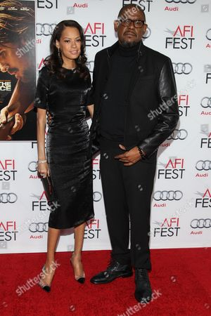 """Actor Forest Whitaker and wife / model Keisha Nash Whitaker arrive at the 2013 AFI Fest premiere of """"Out of the Furnace"""" at the TCL Chinese Theatre on in Los Angeles"""