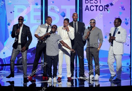 From left, JB Smoove, Duane Martin, Kevin Hart, Nick Cannon, Boris Kodjoe, Nelly, and Bobby Brown speak onstage at the BET Awards at the Nokia Theatre, in Los Angeles