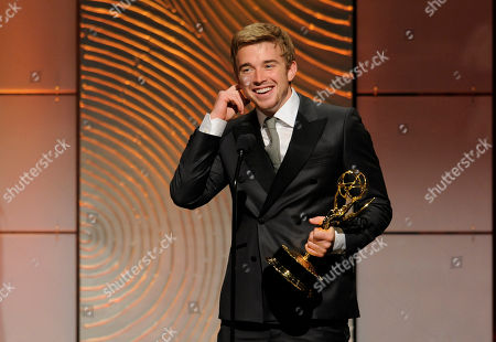 """Chandler Massey accepts the award for outstanding younger actor in a drama series for """"Days of our Lives"""" at the 40th Annual Daytime Emmy Awards, in Beverly Hills, Calif"""