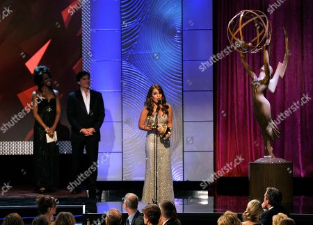 "Kristen Alderson accepts the award for outstanding younger actress in a drama series for ""General Hospital"" at the 40th Annual Daytime Emmy Awards, in Beverly Hills, Calif. Looking on at second left is presenter Vincent Irizarry"