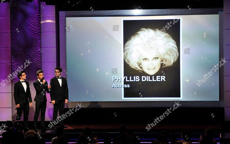 From left, Piero Barone, Gianluca Ginoble and Ignazio Boschetto, of musical group Il Volo, perform during an in memoriam tribute at the 40th Annual Daytime Emmy Awards, in Beverly Hills, Calif. Pictured on screen is Phyllis Diller