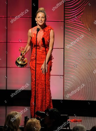 """Julie Marie Berman accepts the award for outstanding supporting actress in a drama series for """"General Hospital"""" at the 40th Annual Daytime Emmy Awards, in Beverly Hills, Calif"""