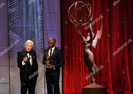 Wayne Brady, right, presents the lifetime achievement award to Monty Hall at the 40th Annual Daytime Emmy Awards, in Beverly Hills, Calif
