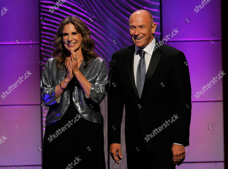 Jess Walton, left, and Corbin Bernsen present an in memoriam tribute at the 40th Annual Daytime Emmy Awards, in Beverly Hills, Calif