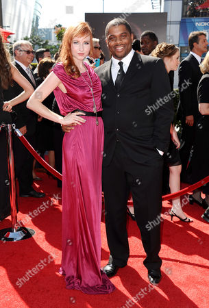 Stock Photo of From left, Mary Kate Wiles and guest arrive at the 2013 Primetime Creative Arts Emmy Awards, on at Nokia Theatre L.A. Live, in Los Angeles, Calif