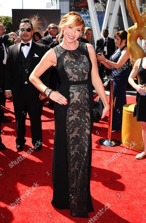 Kari Byron arrives at the 2013 Primetime Creative Arts Emmy Awards, on at Nokia Theatre L.A. Live, in Los Angeles, Calif