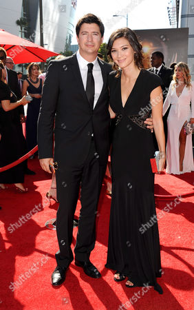 From left, Ken Marino and Erica Oyama arrive at the 2013 Primetime Creative Arts Emmy Awards, on at Nokia Theatre L.A. Live, in Los Angeles, Calif