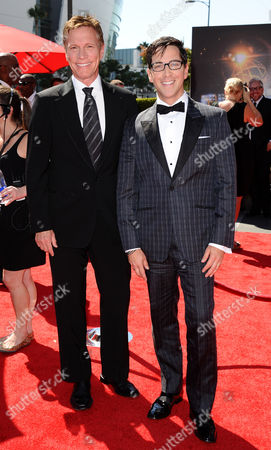 Don Roos, left, and Dan Bucatinsky arrive at the 2013 Primetime Creative Arts Emmy Awards, on at Nokia Theatre L.A. Live, in Los Angeles, Calif