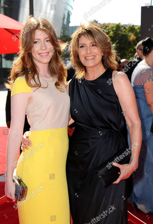 Pamela Fryman, right, and guest arrive at the 2013 Primetime Creative Arts Emmy Awards, on at Nokia Theatre L.A. Live, in Los Angeles, Calif