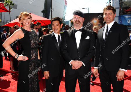 From left, Kari Byron, Grant Imahara, Jamie Hyneman and Tory Belleci arrive at the 2013 Primetime Creative Arts Emmy Awards, on at Nokia Theatre L.A. Live, in Los Angeles, Calif